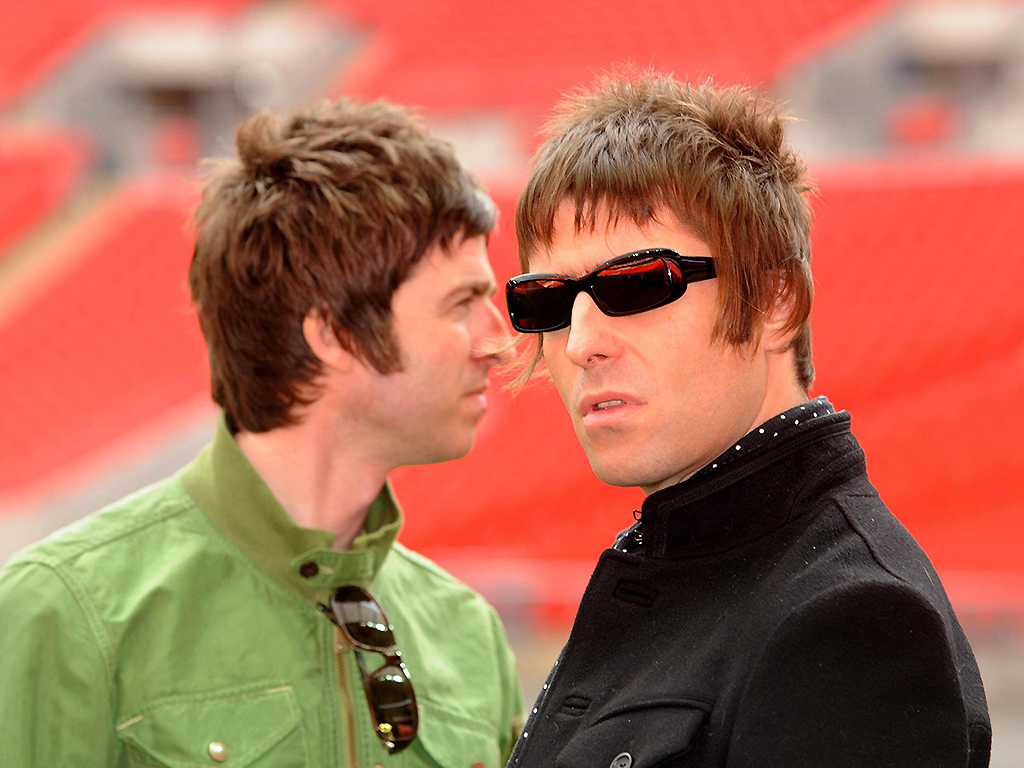 Noel Gallagher and Liam Gallagher, pictured during a photocall at Wembley Stadium in 2008.
