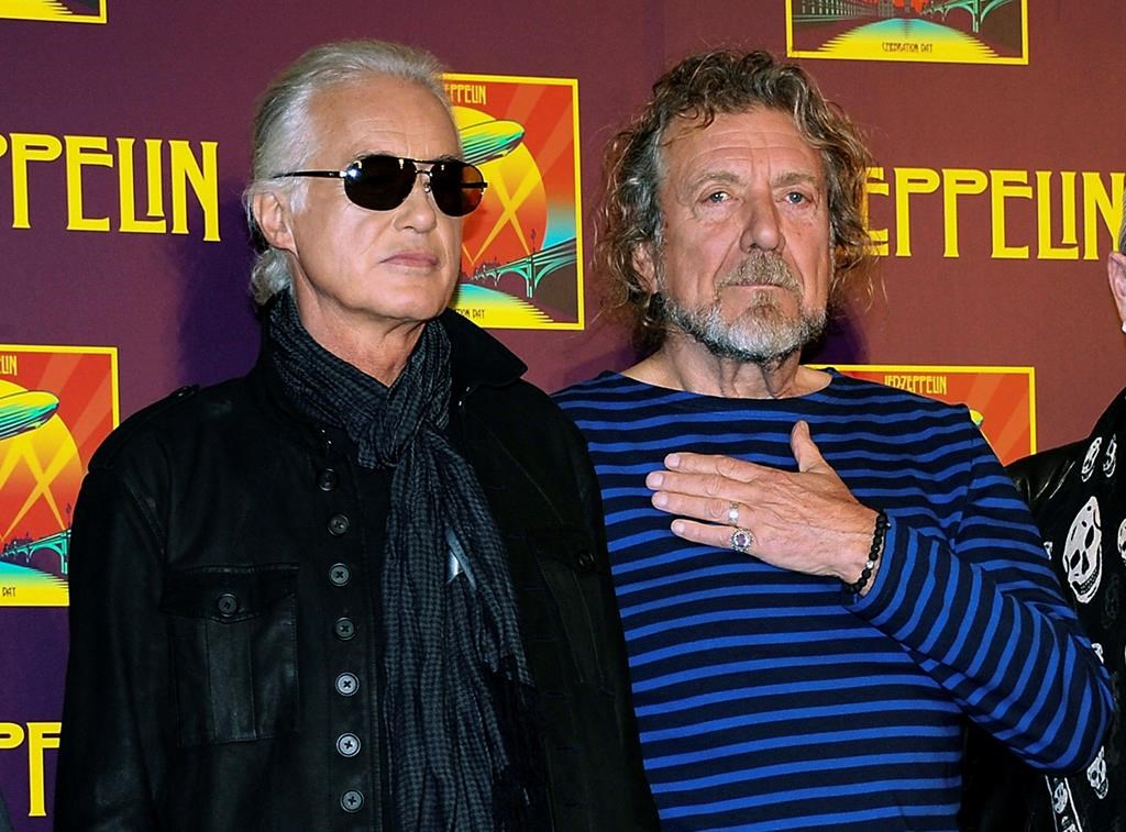 In this Oct. 9, 2012 file photo, Led Zeppelin guitarist Jimmy Page, left, and singer Robert Plant appear at a news conference ahead of the worldwide theatrical release of 'Celebration Day,' a concert film of their 2007 London O2 arena reunion show, in New York City.