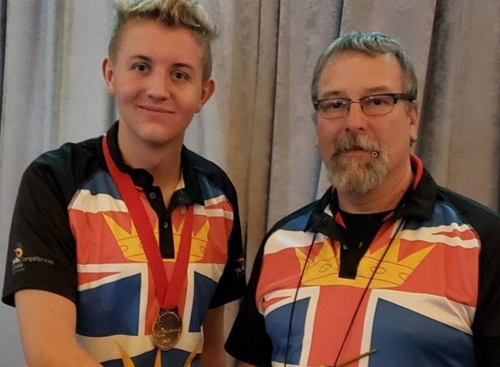 Pleasant Valley Secondary School Aidan Eglin, left, and teacher Phil Lepine in their Team B.C. shirts at the Skills Canada event in Halifax.