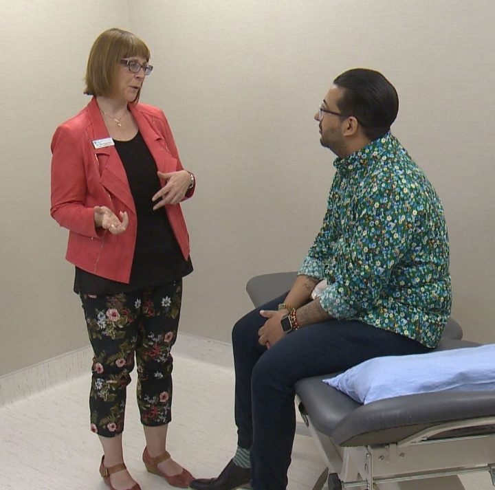 Dr. Lori Montgomery, medical leader of the Calgary Pain Program, talks to Shan Rahim, a patient receiving medically supervised opioid tapering, on June 10, 2019.