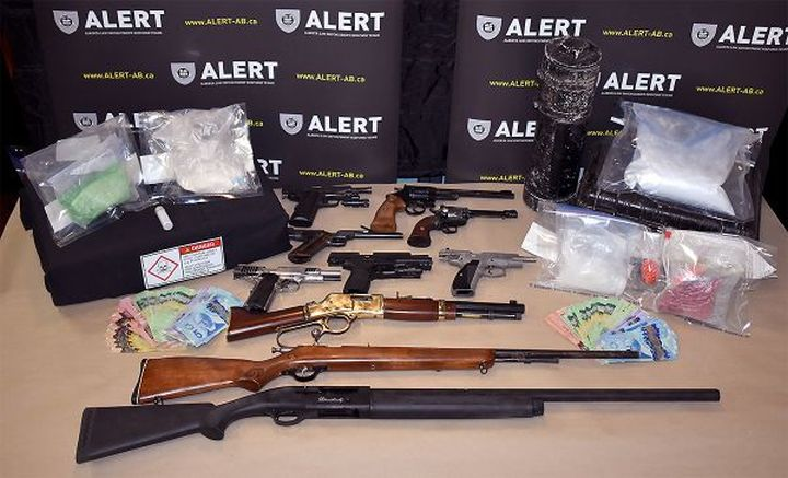Seven people are facing more than 175 charges after 12 guns and nearly $200,000 worth of drugs were seized from a rural property in Peace River, Alta.