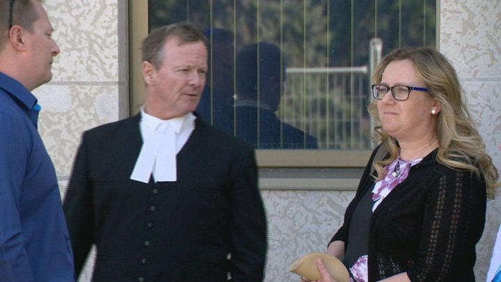 Carolyn Strom meets with her lawyer Marcus Davies outside Regina's Court of Queen's Bench June 4, 2019.