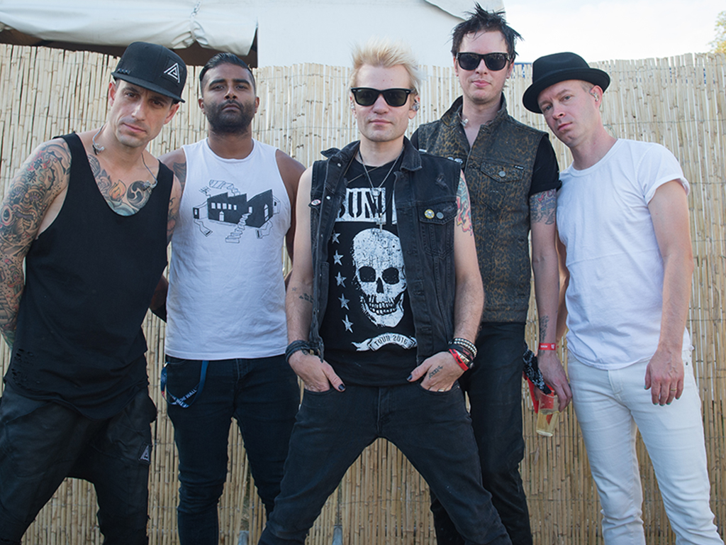 Sum 41: (L-R) Frank Zummo, Dave Baksh, Deryck Whibley, Jason McCaslin and Tom Thacker posing for a photo session at Rock en Seine on Aug. 28, 2016 in Paris, France.