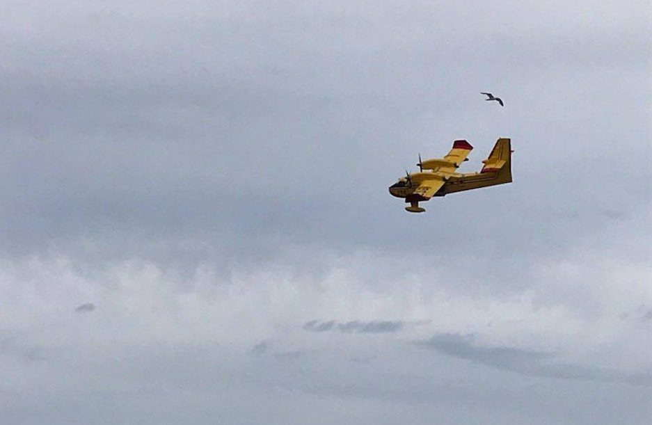A water bomber seen earlier Friday helping to fight the Traverse Bay forest fire.