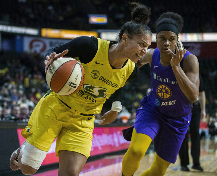 Seattle Storm's Alysha Clark drives against a Los Angeles Sparks player during a WNBA basketball game Friday, June 21, 2019, in Everett, Wash.