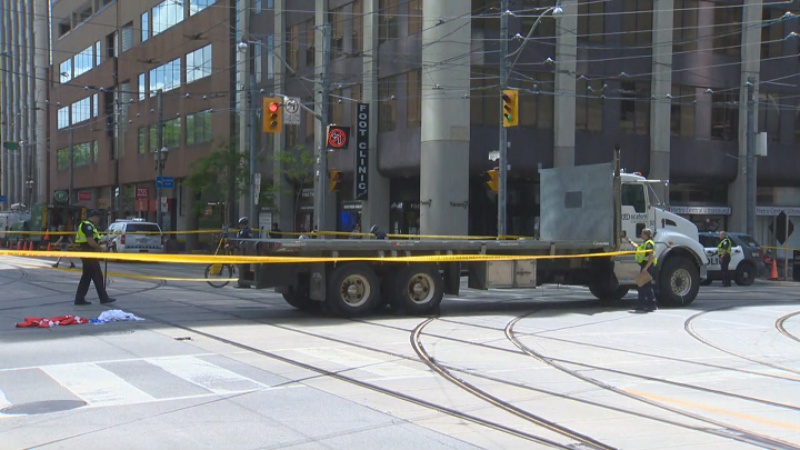 A woman has died after being hit by a truck in downtown Toronto Wednesday morning.