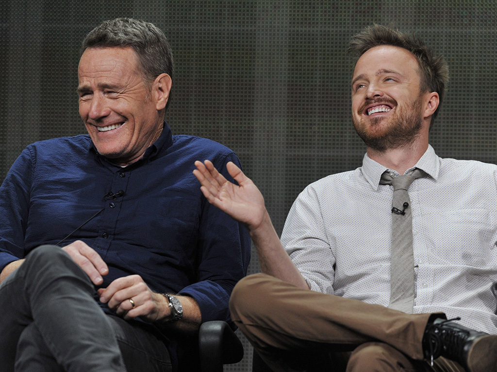 Bryan Cranston, left, and Aaron Paul, cast members in the television series 'Breaking Bad,' share a laugh onstage during AMC's Summer 2013 TCA press tour at The Beverly Hilton Hotel on Friday, July 26, 2013, in Beverly Hills, Calif.