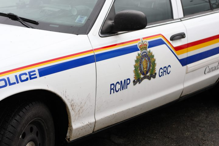 Two people were injured after a truck and train collided in Brooks on Friday.