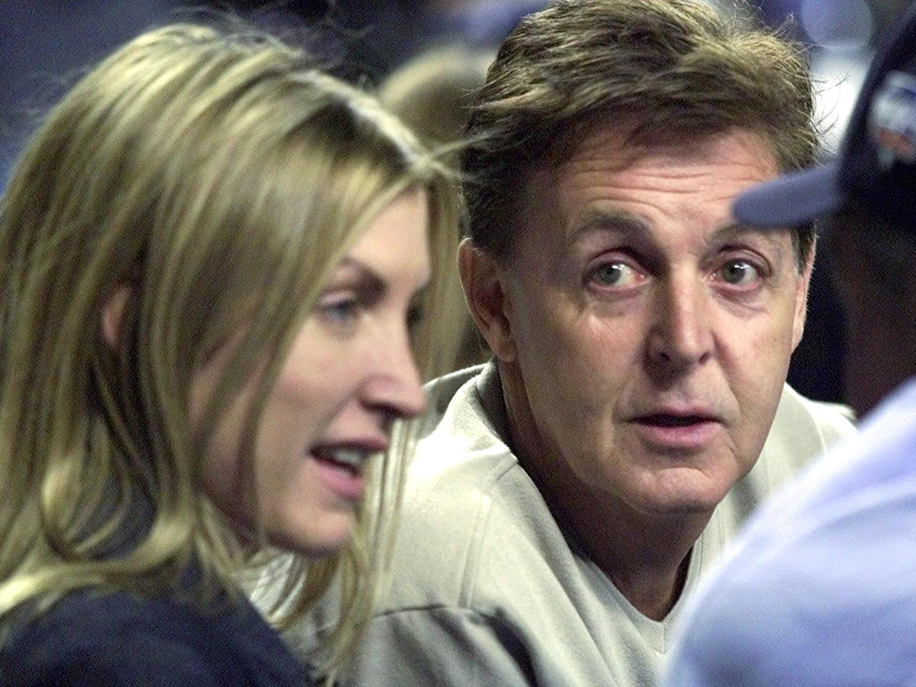 Paul McCartney, centre, and his ex-wife Heather Mills chat before the Seattle Mariners and New York Yankees play in Game 4 of the American League Championship at Yankee Stadium Sunday, Oct. 21, 2001 in New York City.