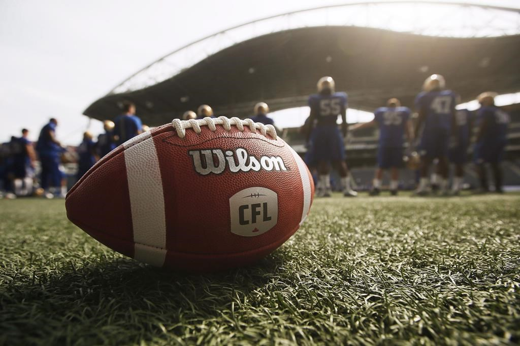 A CFL ball is photographed at the Winnipeg Blue Bomber stadium in Winnipeg. The CFL denied reports Winnipeg would be a hub city should the league run a shortened season this year amid COVID-19.