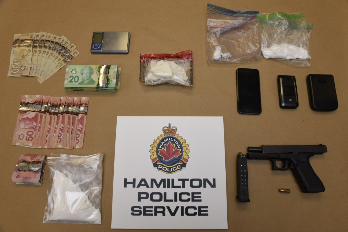 Police arrested two people and seized drugs, guns and cash following an investigation in Hamilton's east end.