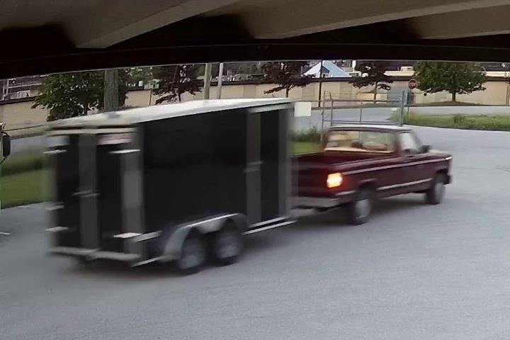 Police are investigating after someone driving a red pickup truck allegedly stole a black enclosed trailer from a Severn Township business on June 22, OPP say.
