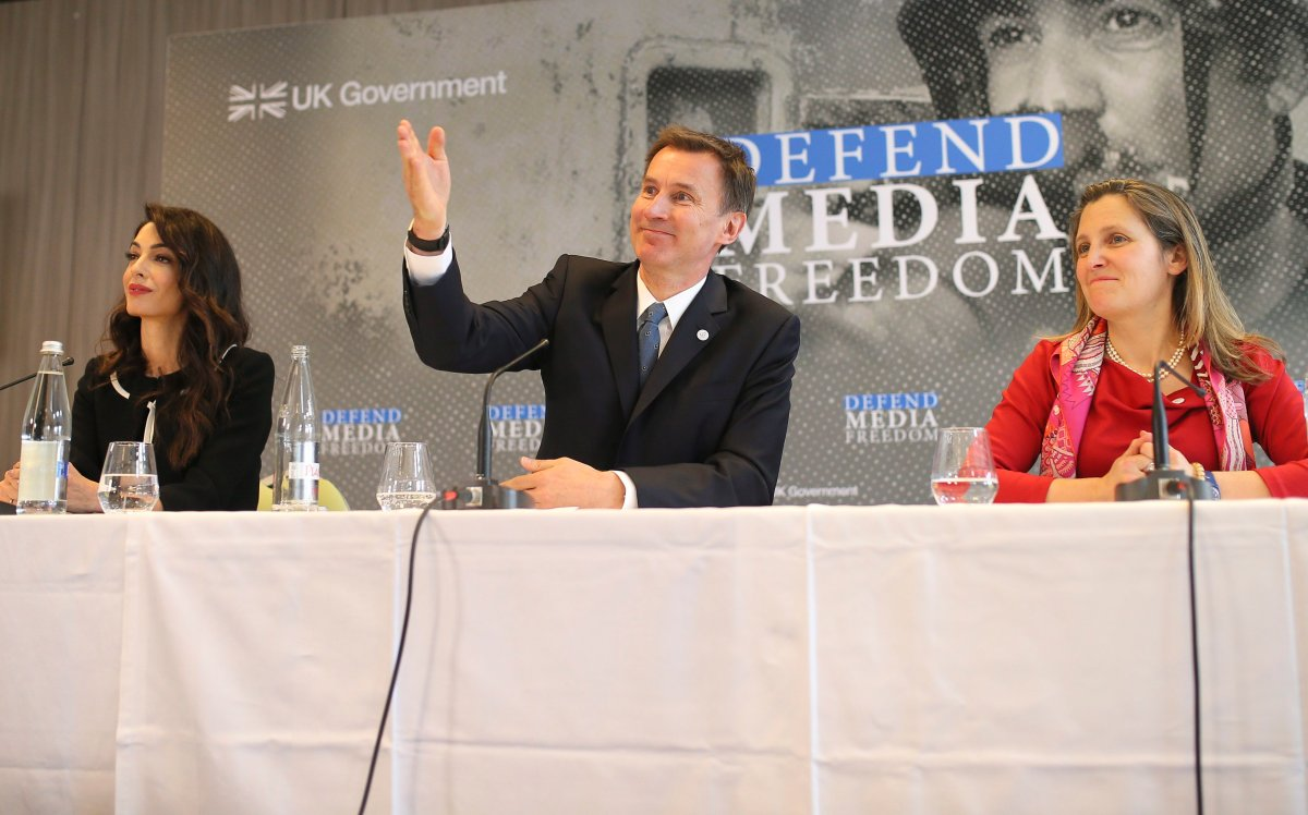 International human rights lawyer Amal Clooney, left, Britain's Foreign Secretary Jeremy Hunt and Canada's Minister of Foreign Affairs Chrystia Freeland, right, attend a meeting in Dinard, Brittany, Friday, April 5, 2019.