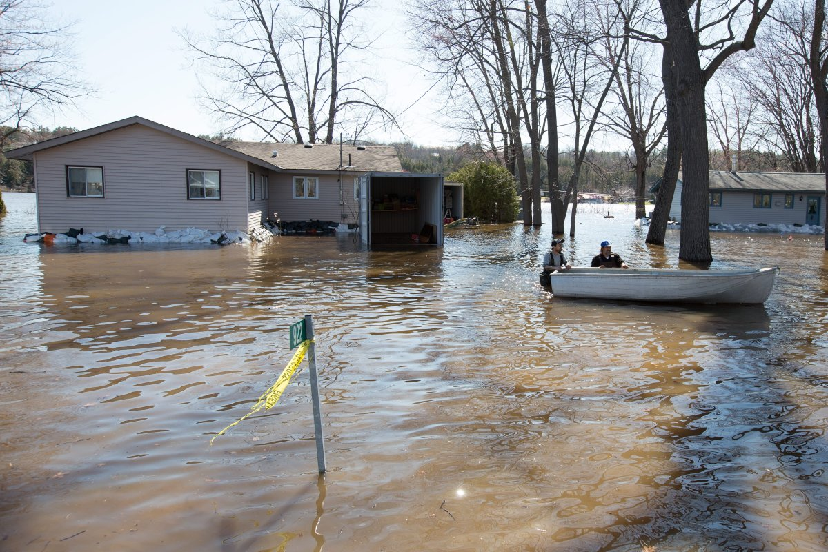 Flood water surround a home in Constance Bay, Ontario on Sunday, April 28, 2019.