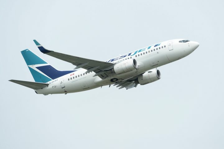 A WestJet plane takes off from Vancouver International Airport in Vancouver on Monday, May 13, 2019.