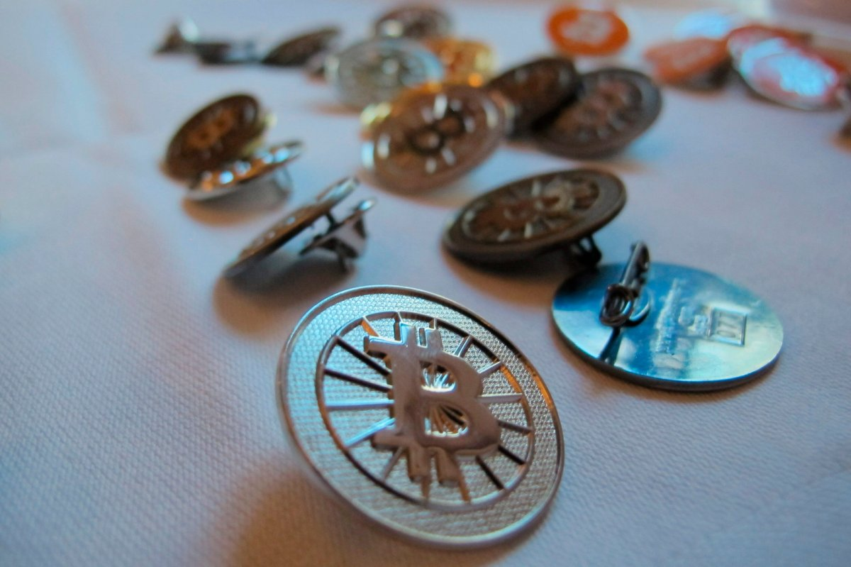 FILE-In this Feb. 12, 2014 file photo Bitcoin buttons are displayed on a table at the Inside Bitcoins conference in Berlin.