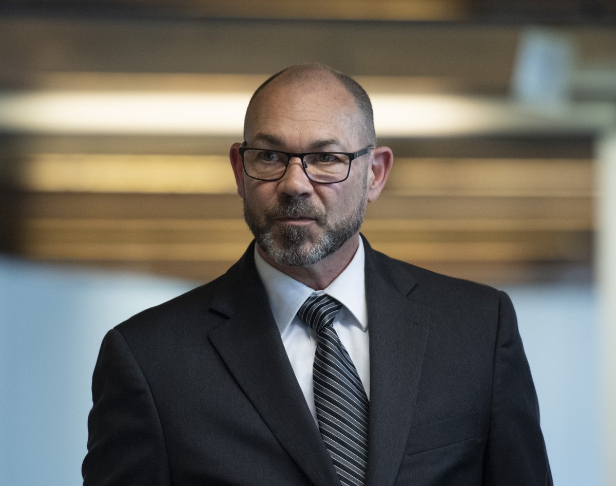 Colonel Mario Dutil returns to the courtroom after a break during his court martial at the Asticou Centre in Gatineau, Que., on June 10, 2019.