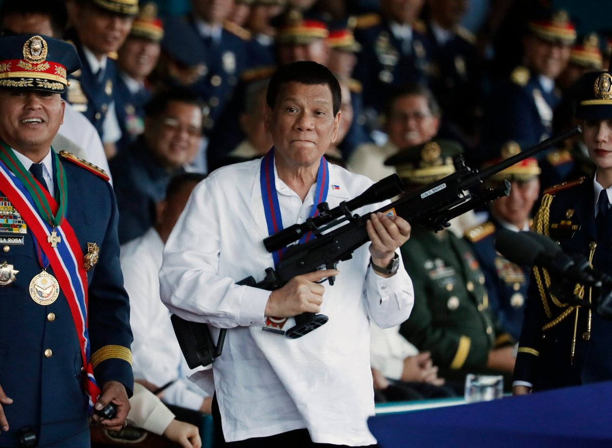 FILE - Filipino President Rodrigo Duterte (C) holds a Galil sniper rifle during the national police chief change of command ceremony inside Camp Crame in Quezon city, east of Manila, Philippines, 19 April 2018 (issued 12 July 2019).