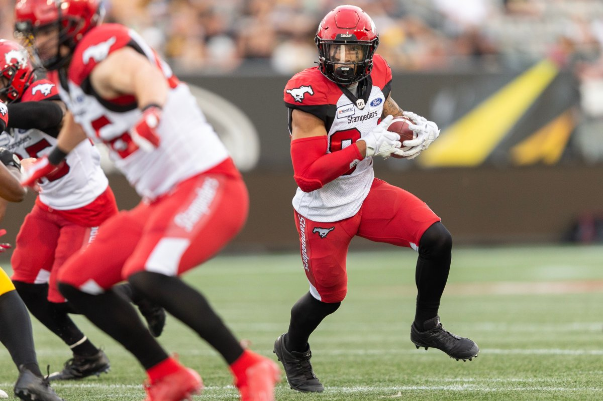 Calgary's Reggie Begelton runs the ball for a  touchdown during second quarter CFL action between the Stampeders and the Hamilton Tiger-Cats in Hamilton, Ontario on Saturday July 13, 2019.