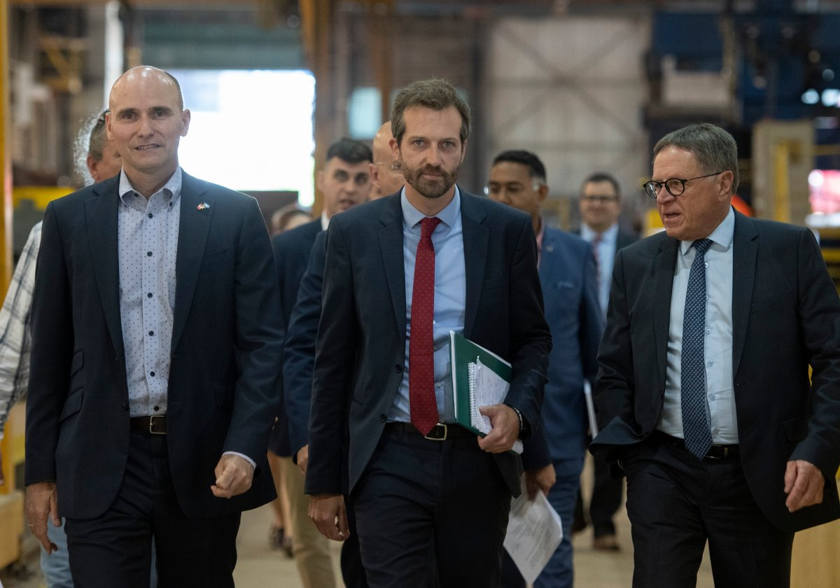 Jean-Yves Duclos, Minister of Families, Children and Social Development, from the left, Joel Lightbound, Parliamentary Secretary to the Minister of Finance and Levis mayor Gilles Lehouillier, arrive to announce a contract given to Davie shipyard, Tuesday, July 16, 2019 in Levis Que. THE CANADIAN PRESS/Jacques Boissinot.