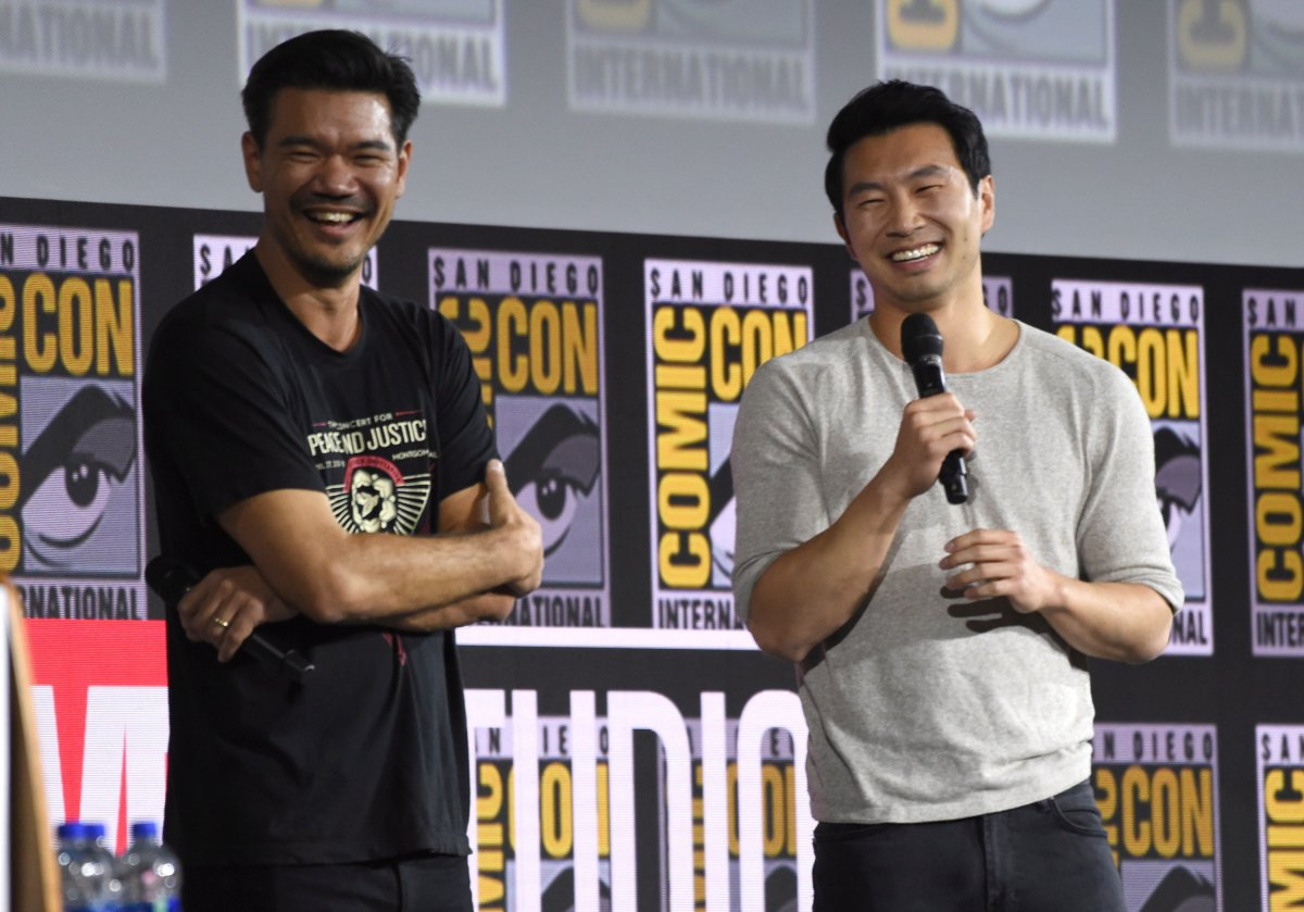 """Destin Daniel Cretton, left, and Simu Liu speaks during the """"Shang-Chi and The Legend of the Ten Rings"""" portion of the Marvel Studios panel on day three of Comic-Con International on Saturday, July 20, 2019, in San Diego."""