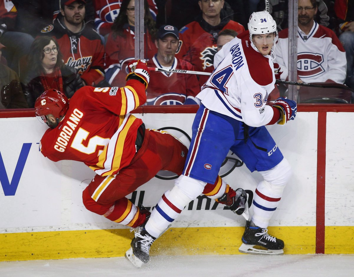 Michael McCarron and the Montreal Canadiens agreed to terms on a one-year, two-way contract on Saturday. Montreal Canadiens' Michael McCarron, right, checks Calgary Flames' Mark Giordano during third period NHL hockey action, March 9, 2017.
