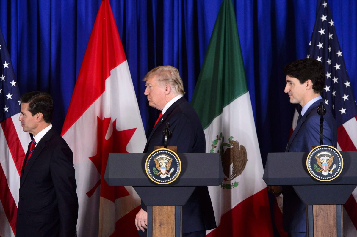 Prime Minister Justin Trudeau participates in a signing ceremony for the new United States-Mexico-Canada Agreement with President of the United States Donald Trump and President of Mexico Enrique Pena Nieto in Buenos Aires, Argentina on Friday, Nov. 30, 2018.