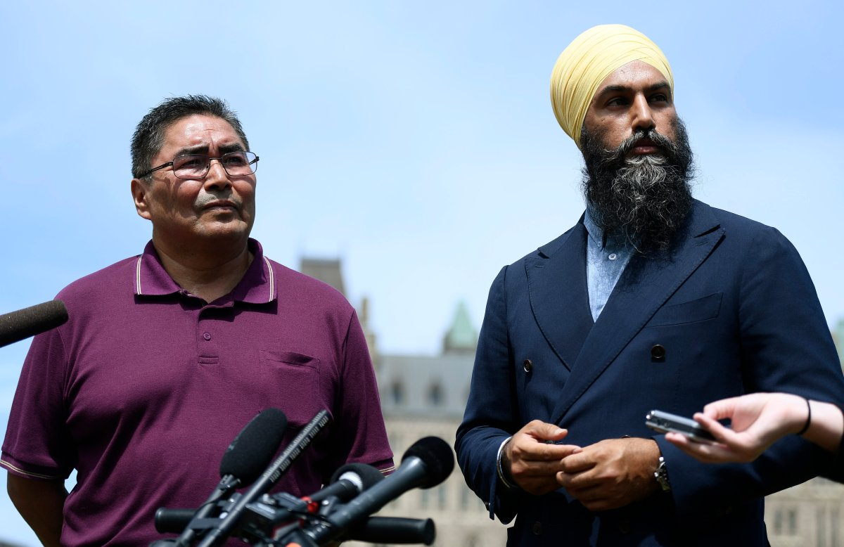 NDP leader Jagmeet Singh, right, and Chief Rudy Turtle of the Grassy Narrows First Nation listen to questions during a press conference announcing his candidacy for the NDP in Kenora, Ont. for the fall election, on the lawn of Parliament Hill in Ottawa on Monday, July 29, 2019.