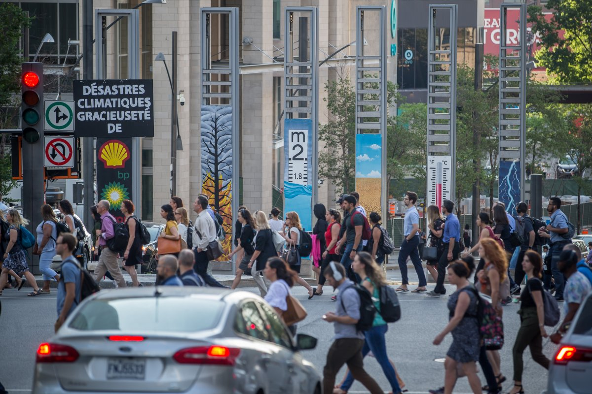 Six 13-feet-long posters were put up at the intersection of de la Gauchetière Street and Robert-Bourassa Boulevard.