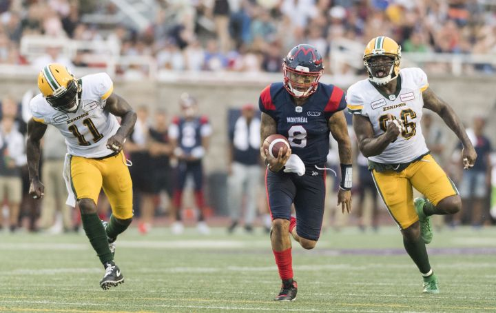 Montreal Alouettes quarterback Vernon Adams Jr. (8) breaks away from Edmonton Eskimos' Larry Dean (11) and Mike Moore during second half CFL football action in Montreal, Saturday, July 20, 2019.