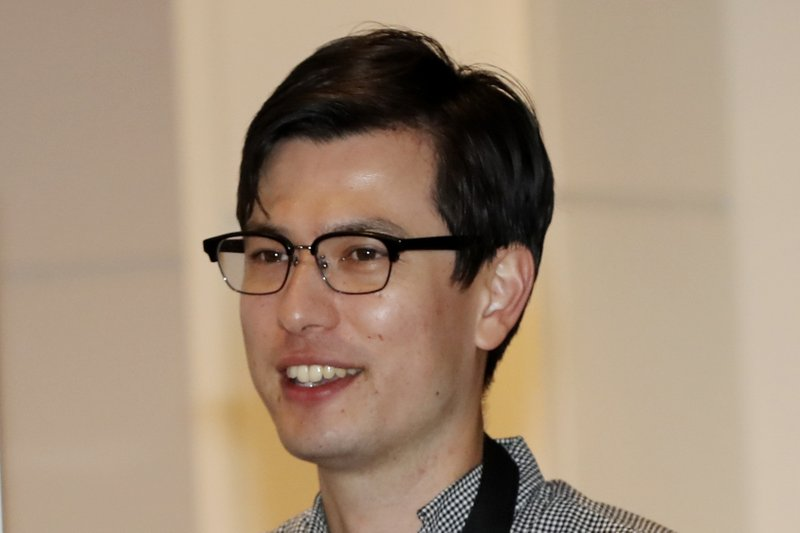 Australian student Alek Sigley arrives at the airport in Tokyo on Thursday, July 4, 2019. The Australian student who vanished in North Korea more than a week ago arrived in Tokyo Thursday, July 4, 2019.