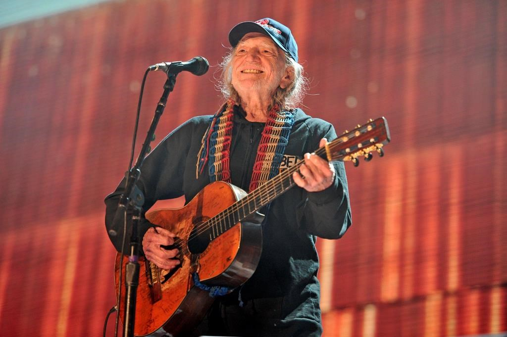 FILE - In this Sept. 19, 2015 file photo, Willie Nelson performs at Farm Aid 30 at FirstMerit Bank Pavilion at Northerly Island in Chicago. Nelson, John Mellencamp, Neil Young and Dave Matthews headline Farm Aid 2019 when the annual music and food festival visits Wisconsin's dairy country in September. Tickets for the Sept. 21 event at the Alpine Valley Music Theatre in East Troy, Wisconsin, go on sale Friday, July 12, 2019. (Photo by Rob Grabowski/Invision/AP, File).