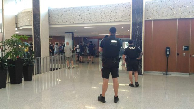 Hamilton police officers look on after a tense meeting of Hamilton's police services board was disrupted by yelling from the public gallery on Wednesday.