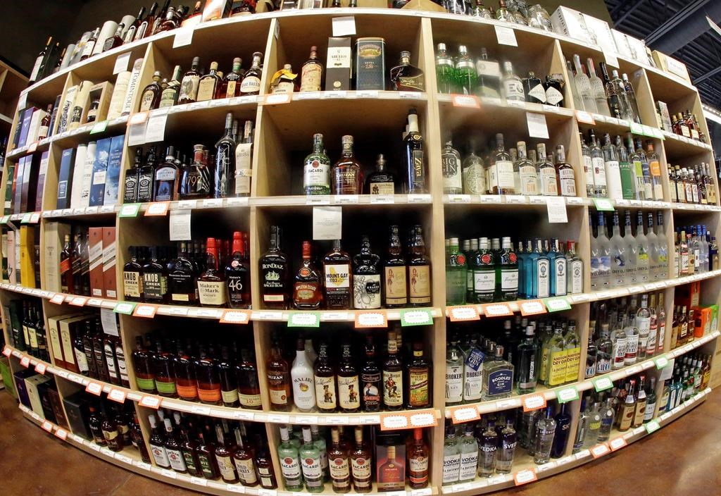 This June 16, 2016 file photo made with a fisheye lens shows bottles of alcohol during a tour of a liquor store.