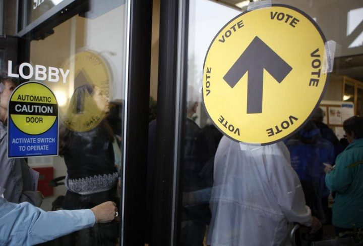 Voters wait in line to cast their ballots both inside and outside the SHOAL Centre on election day in Sidney, B.C., on Oct. 19, 2015. THE CANADIAN PRESS/Chad Hipolito.