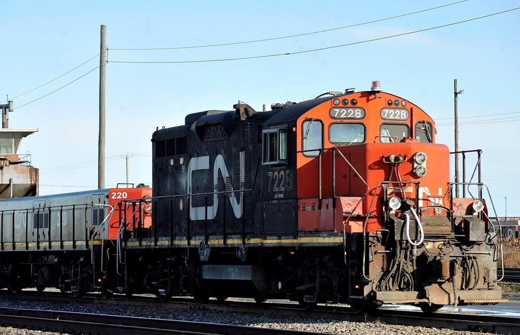 A CN locomotive makes its way through the CN Taschereau yard in Montreal on Nov., 28, 2009. Canadian National Railway says it is on track to move record quantities of western Canadian grain for the year after a strong June.THE CANADIAN PRESS/Graham Hughes.