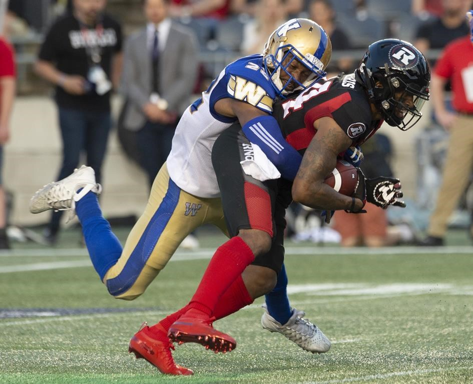 Winnipeg Blue Bombers defensive back Chandler Fenner, left, tackles Ottawa Redblacks wide receiver R.J. Harris during second quarter CFL action in Ottawa, Friday, July 5, 2019. After a disappointing performance against the Winnipeg Blue Bombers last week, the Redblacks are looking for a solid performance this week against the surging Montreal Alouettes and some new faces could play a significant role. THE CANADIAN PRESS/Adrian Wyld.