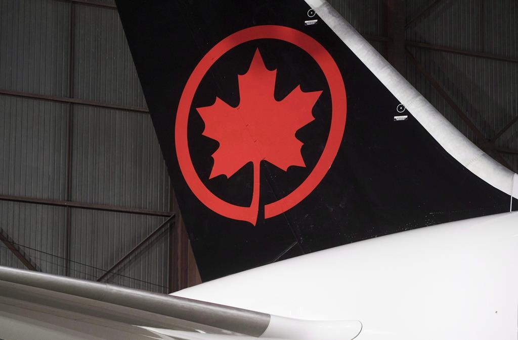 The tail of an Air Canada aircraft is seen at a hangar at the Toronto Pearson International Airport in Mississauga, Ont., on Feb. 9, 2017.