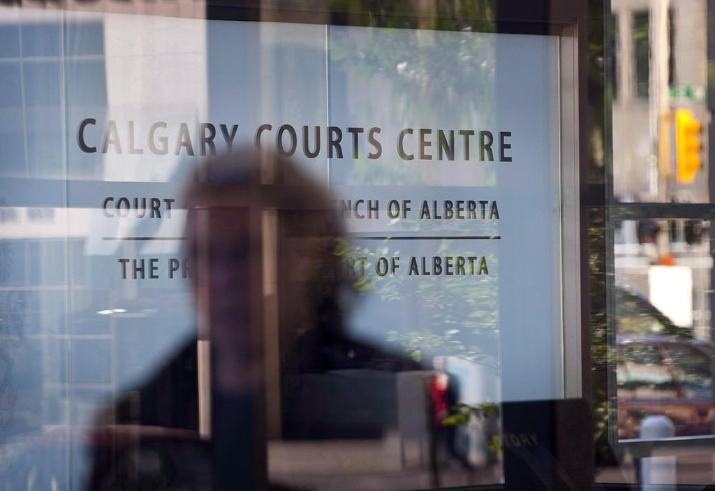 An entrance to the Calgary Courts Centre is shown in Calgary on Aug. 27, 2010. A class-action lawsuit filed on behalf of several young men accusing a former employee of The Young Canadians of sexual abuse has passed its first major hurdle.