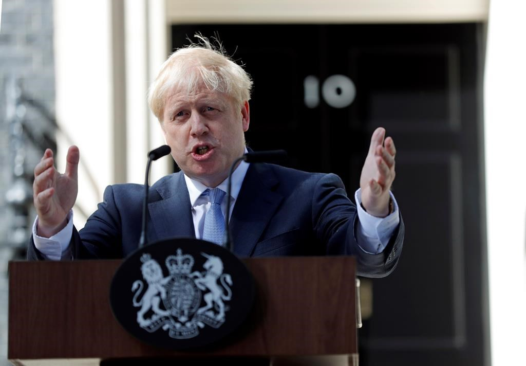 "Britain's new Prime Minister Boris Johnson gestures as he speaks outside 10 Downing Street, London, Wednesday, July 24, 2019. Boris Johnson pledged a Halloween Brexit for Britain from the European Union, negotiated or not, ""no ifs or buts"", after being sworn in Wednesday as Britain's prime minister."