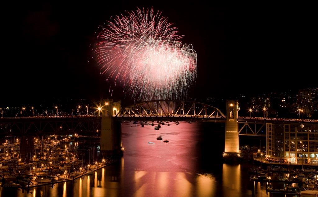 The Burrard Street Bridge is seen in the foreground as fireworks from team China blast over the waters of English Bay during the 21st annual Celebration of Light in Vancouver, Saturday, July 30, 2011. Vancouver's 29th annual fireworks extravaganza is set to showcase the pyrotechnical skills of India, Croatia and Canada as the three countries light up the sky this summer.