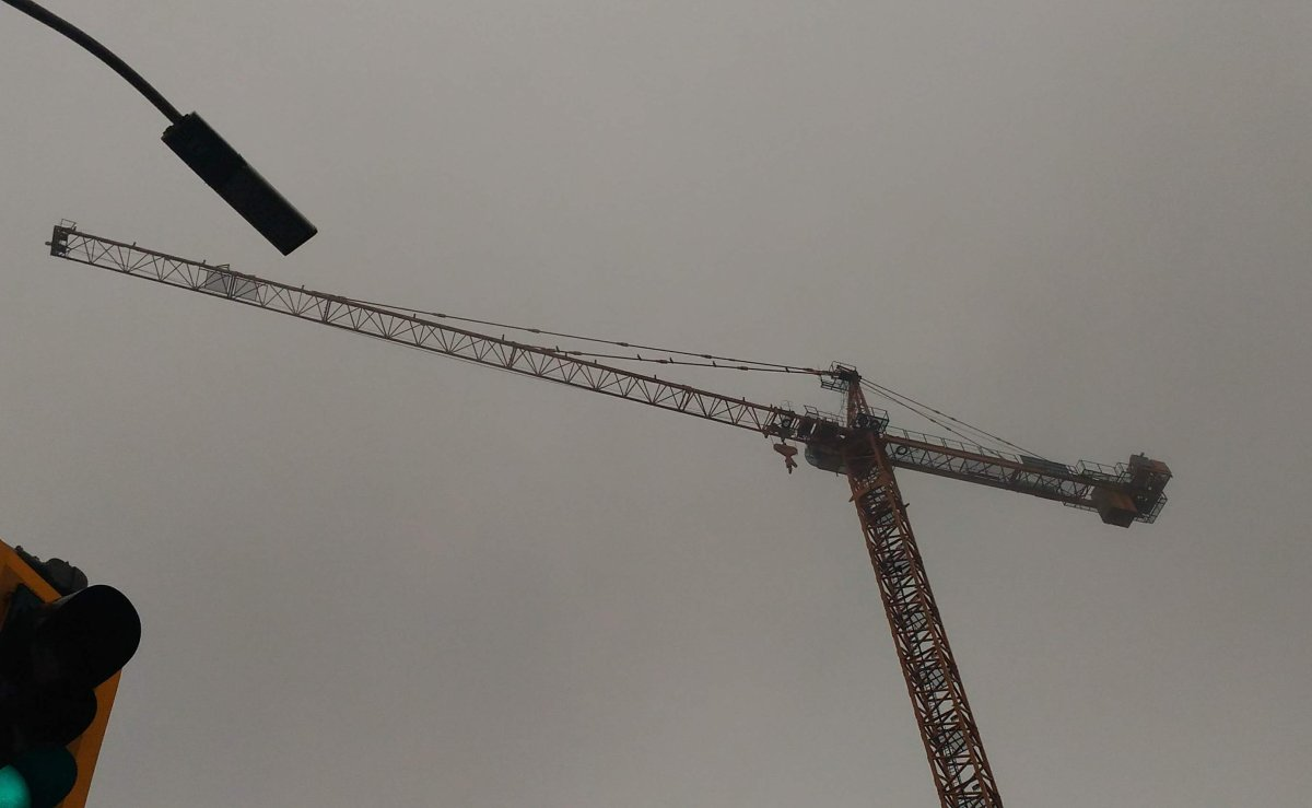 Hamilton police say a man climbed a downtown construction crane on Tuesday.