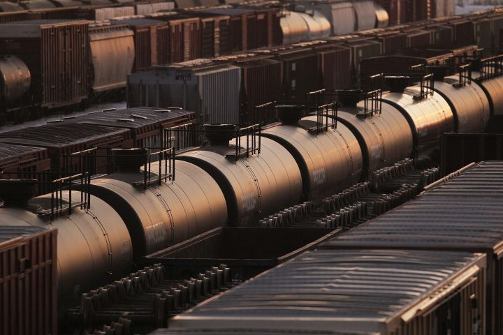 Rail cars are seen in Winnipeg, Sunday, March 23, 2014. Canada's largest oil producers are calling on the Alberta government to reward companies that commit to adding crude-by-rail capacity by easing their curtailment levels.
