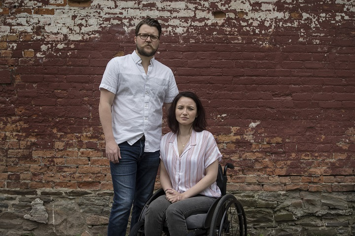 Survivors of the Danforth shooting attack Jerry Pinksen, left, and his partner Danielle Kane pose for a photograph at Liberty Village Park in Toronto on Friday, July 12, 2019.