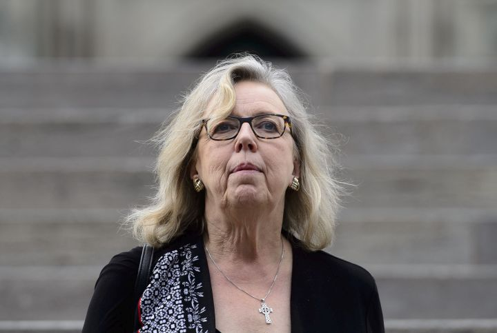 Green Party Leader Elizabeth May makes her way from Parliament Hill in Ottawa on Tuesday, June 18, 2019. With exactly three months until Canadians vote in the next federal election, May says her big hope for the final result is a minority government over which she can exert some influence.