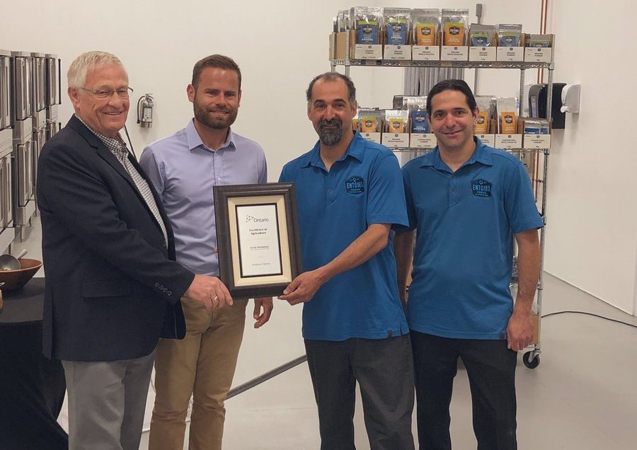 Ontario agriculture minister Ernie Hardeman, left, and MPP David Piccini, present Entomo Farms in Norwood with an Excellence in Agriculture Award on Thursday.