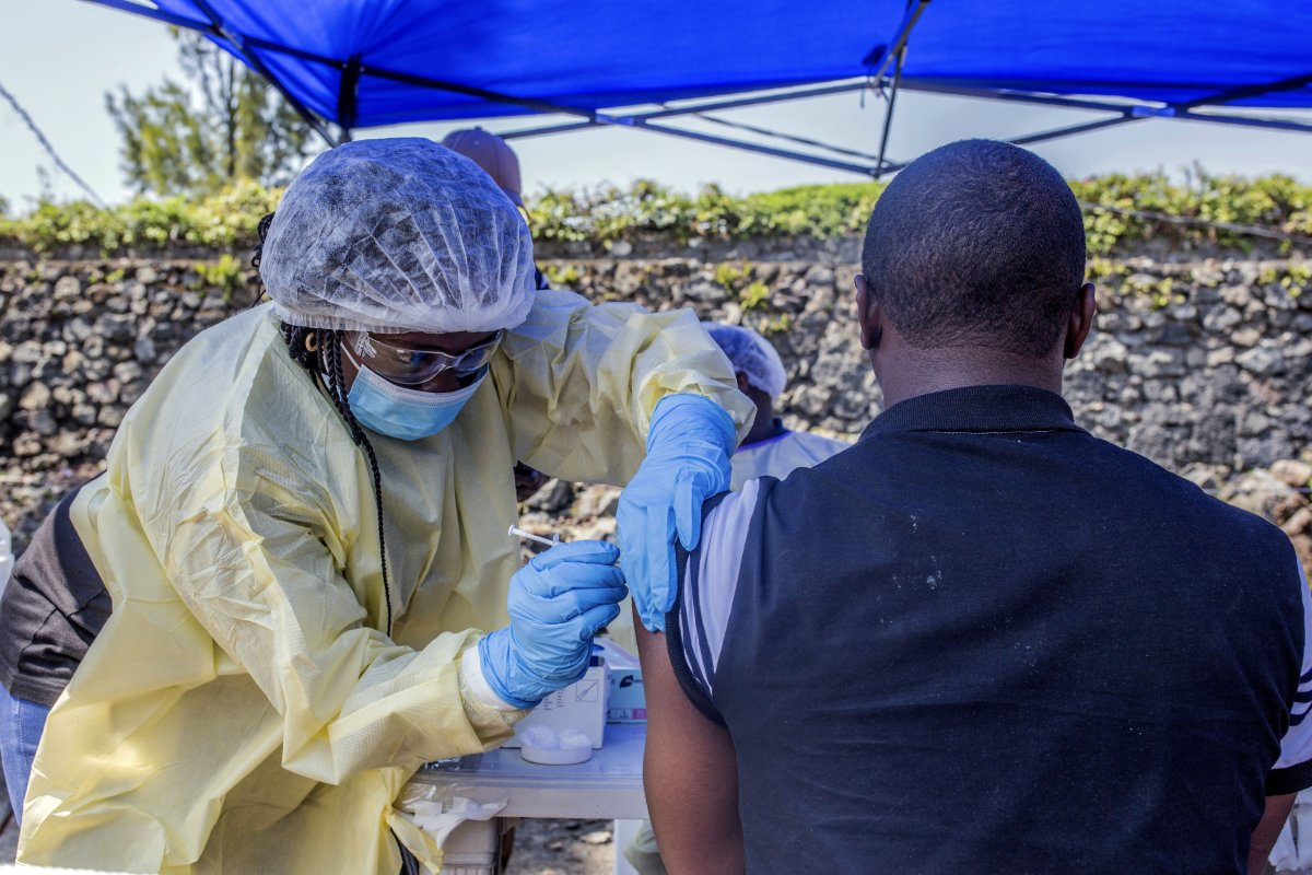A man receives a vaccine against Ebola from a nurse outside the Afia Himbi Health Centre on July 15, 2019 in Goma.