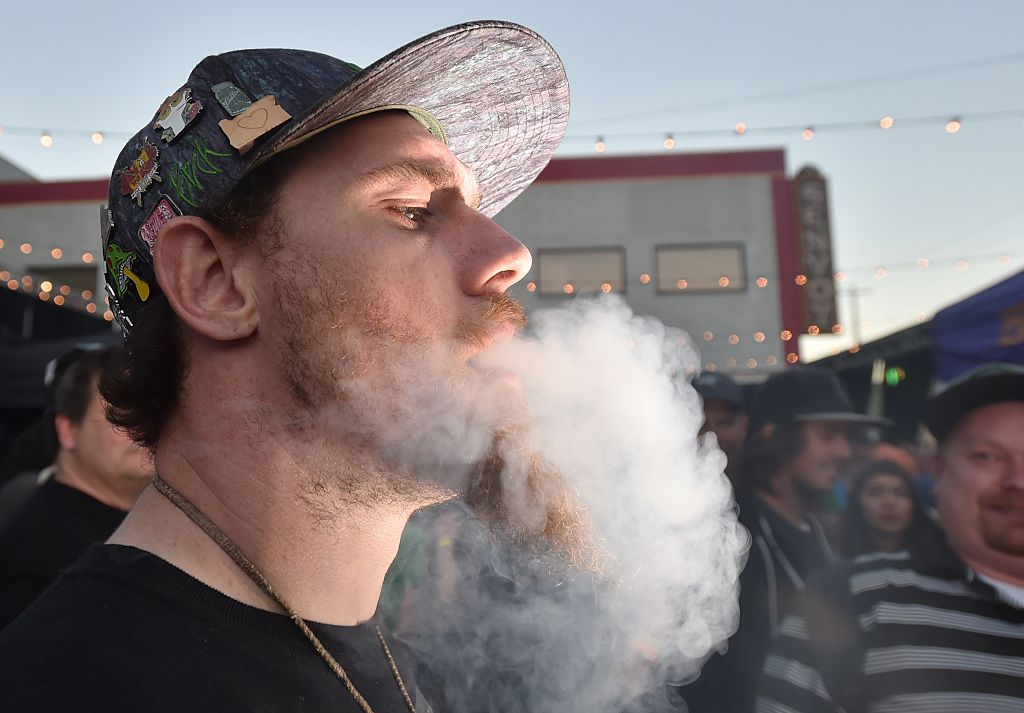 A man smokes a joint at the first annual DOPE Cup, a cannabis competition in Portland, Oregon, in 2015.