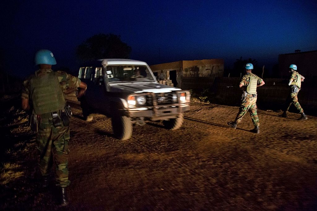 Peacekeeper troops from Ethiopia and deployed in the United Nations (UN) Interim Security Force for Abyei (UNISFA) patrol at night in Abyei town, Abyei state, on December 14, 2016. The Abyei Administrative Area is a disputed territory between Sudan and South Sudan with a longstanding intercommunal tensions between the Ngok-Dinka ethnic majority and the pastoral Misseriya population, who migrate through the area seasonally from the north. An attack by Government of Sudan forces on Abyei in May 2011 displaced the majority of the Ngok Dinka population, approximately 105,000 people to areas south of the River Kiir, which became overcrowded and are suffering a huge competition over natural .