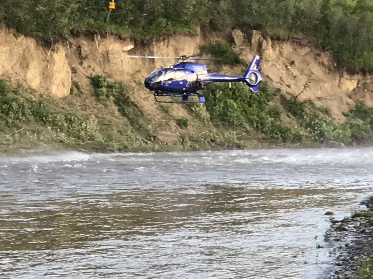Crews search for a man believed to have fallen in the Highwood River southeast of Calgary, June 30, 2019.